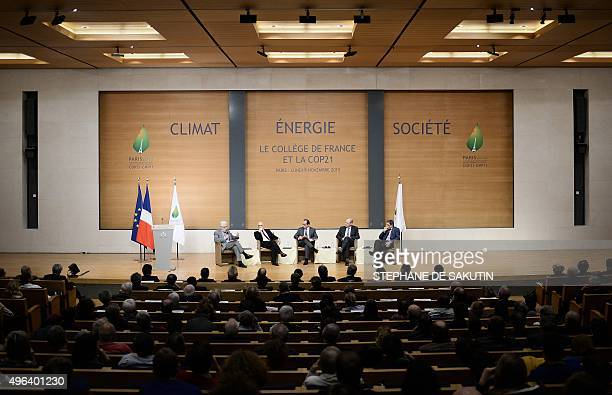 French President Francois Hollande flanked by professors Philippe Descola Alain Prochiantz Edouard Bard and JeanMarie Tarascon takes part in a...