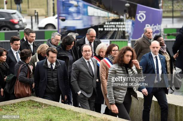 French President Francois Hollande followed by French member of Parliament Elisabeth Guigou and French Labour Minister Myriam El Khomri visits...