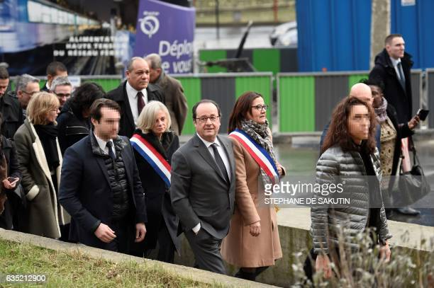 French President Francois Hollande followed by French member of Parliament Elisabeth Guigou visits Aubervilliers north of Paris on February 14 2017...