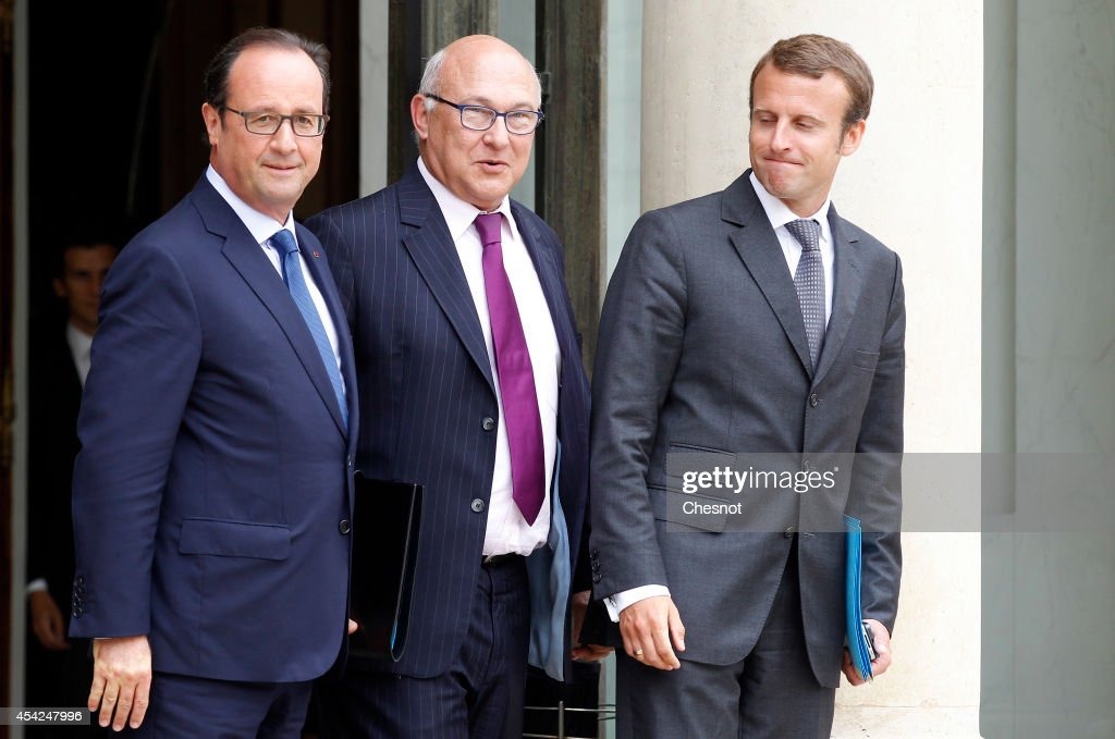 French President Francois Hollande (L), French Finance Minister <a gi-track='captionPersonalityLinkClicked' href=/galleries/search?phrase=Michel+Sapin&family=editorial&specificpeople=668944 ng-click='$event.stopPropagation()'>Michel Sapin</a> (C) and newly-appointed Economy Minister <a gi-track='captionPersonalityLinkClicked' href=/galleries/search?phrase=Emmanuel+Macron&family=editorial&specificpeople=9899223 ng-click='$event.stopPropagation()'>Emmanuel Macron</a> pose as they leave after a weekly cabinet meeting at the Elysee presidential palace on August 27, 2014 in Paris, France.Francois Hollande was forced into the third major overhaul of his ministerial team in two years after a dispute over hauling the economy out of stagnation prompted the government's collapse.