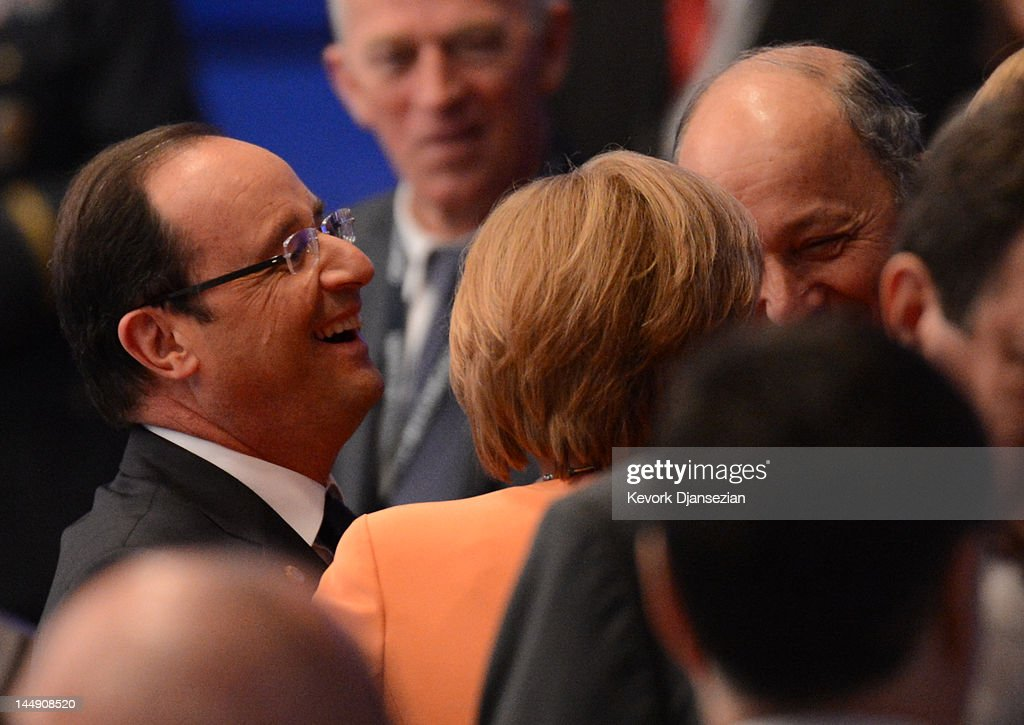 French President Francois Hollande (L), German Chancellor <a gi-track='captionPersonalityLinkClicked' href=/galleries/search?phrase=Angela+Merkel&family=editorial&specificpeople=202161 ng-click='$event.stopPropagation()'>Angela Merkel</a> (C) and Romanian President <a gi-track='captionPersonalityLinkClicked' href=/galleries/search?phrase=Traian+Basescu&family=editorial&specificpeople=542324 ng-click='$event.stopPropagation()'>Traian Basescu</a> share a laugh during the NATO summit on May 20, 2012 in Chicago, Illinois. As sixty heads of state converge for the two day summit that will address the situation in Afghanistan among other global defense issues, thousands of demonstrators have taken the streets to protest.