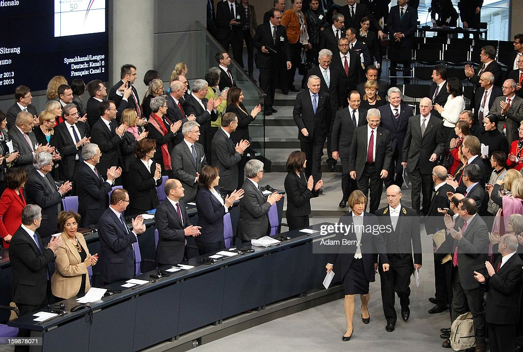 French President Francois Hollande, German Chancellor Angela Merkel, German President Joachim Gauck and President of the German Bundestag Norbert Lammert arrive for a joint session of the German Bundestag and French Assemblee Nationale parliaments in the Reichstag building during the 50th anniversary celebration of the Elysee Treaty on January 22, 2013 in Berlin, Germany. The treaty, concluded in 1963 by Charles de Gaulle and Konrad Adenauer in the Elysee Palace in Paris, set a new tone of reconciliation between France and Germany, and called for consultations between the two countries to come to a common stance on policies affecting the most important partners in Europe as well as the rest of the region. Since its establishment, the document for improved bilateral relations has been seen by many as the driving force behind European integration.