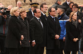 French President Francois Hollande German Chancellor Angela Merkel and Spanish Prime Minister Mariano Rajoy arrive near the site of the German...
