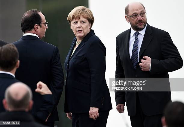 French President Francois Hollande German Chancellor Angela Merkel and President of European Parliament Martin Schulz attend a remembrance ceremony...