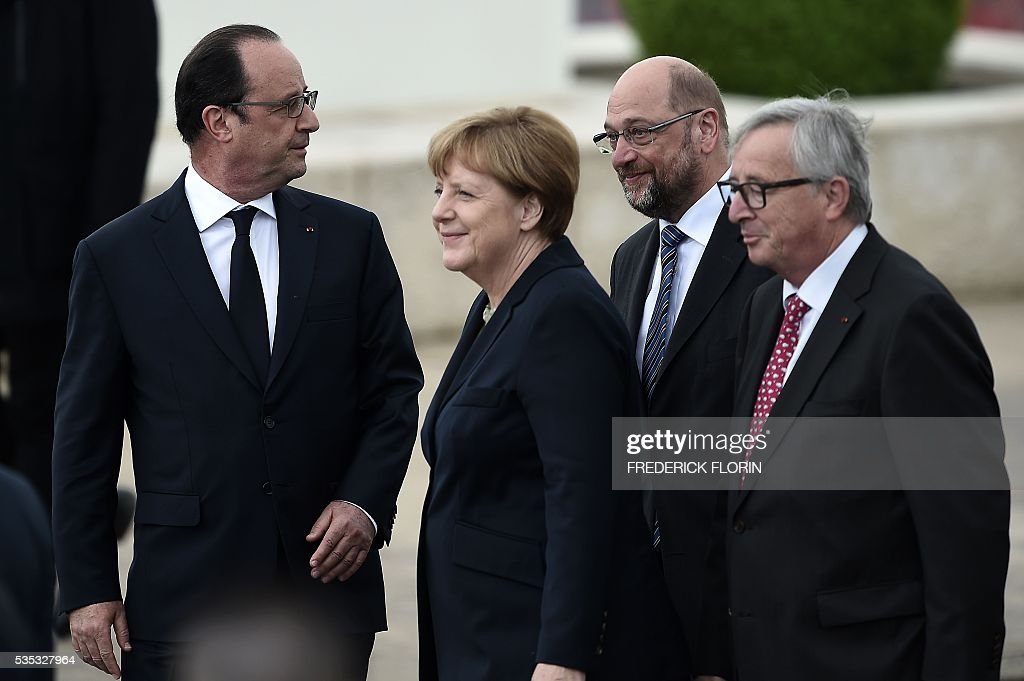 French President Francois Hollande, German Chancellor Angela Merkel, President of European Parliament Martin Schulz and European Commission President Jean Claude Juncker attend a remembrance ceremony to mark the centenary of the battle of Verdun, at the Douaumont Ossuary (Ossuaire de Douaumont), northeastern France, on May 29, 2016. The battle of Verdun, in 1916, was one of the bloodiest episodes of World War I. The offensive which lasted 300 days claimed more than 300,000 lives. / AFP / FREDERICK