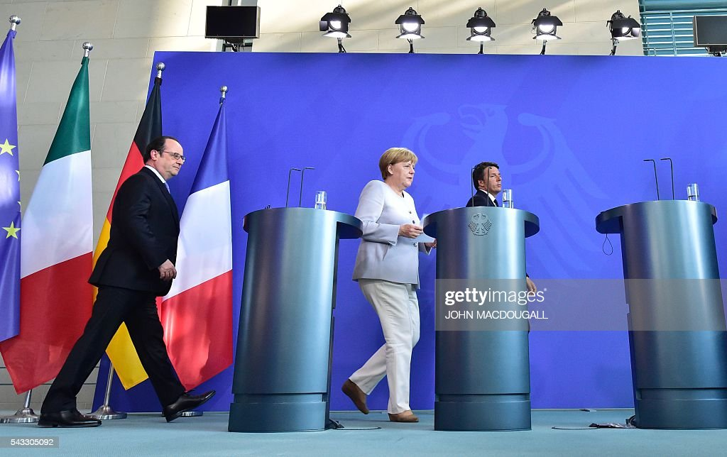 French President Francois Hollande, German Chancellor Angela Merkel and Italy's Prime Minister Matteo Renzi arrive to address a press conference ahead of talks following the Brexit referendum at the chancellery in Berlin, on June 27, 2016. Britain's shock decision to leave the EU forces German Chancellor Angela Merkel into the spotlight to save the bloc, but true to her reputation for prudence, she said she would act neither hastily nor nastily. / AFP / John MACDOUGALL