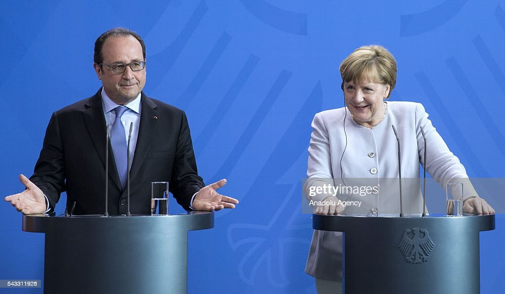 French President Francois Hollande (L), German Chancellor Angela Merkel (R) and Italy's Prime Minister Matteo Renzi (not seen) address a press conference ahead of talks following the Brexit referendum at the chancellery in Berlin, on June 27, 2016.