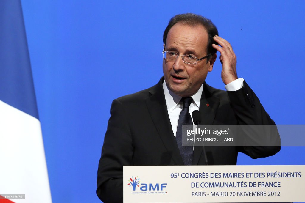 French President Francois Hollande gestures as he delivers a speech during the opening ceremony of the 95th French Mayors congress, on November 20, 2012 in Paris.