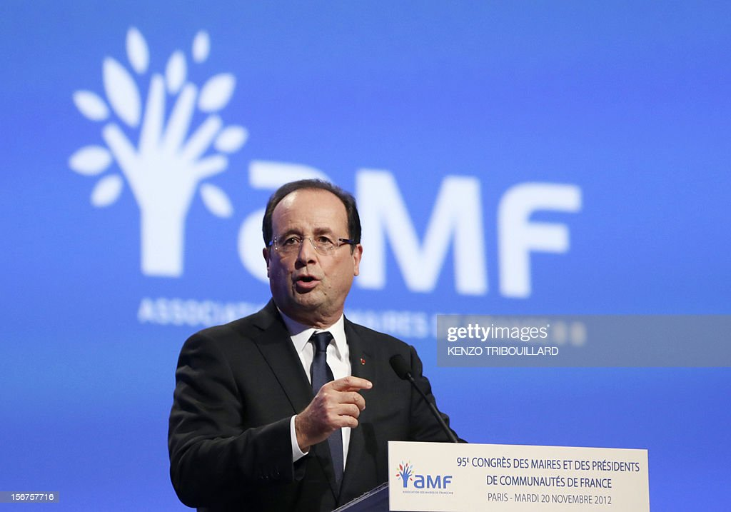 French President Francois Hollande gestures as he delivers a speech during the opening ceremony of the 95th French Mayors congress, on November 20, 2012 in Paris. AFP PHOTO KENZO TRIBOUILLARD