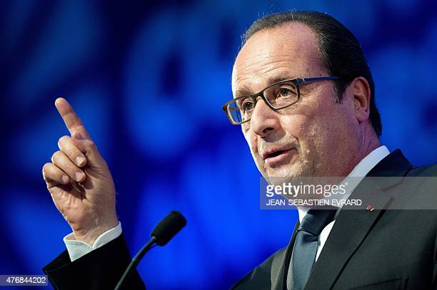 French President Francois Hollande gestures as he delivers a speech during the inauguration of the 'Cite de l'Objet Connecte' in SaintSylvaind'Anjoy...