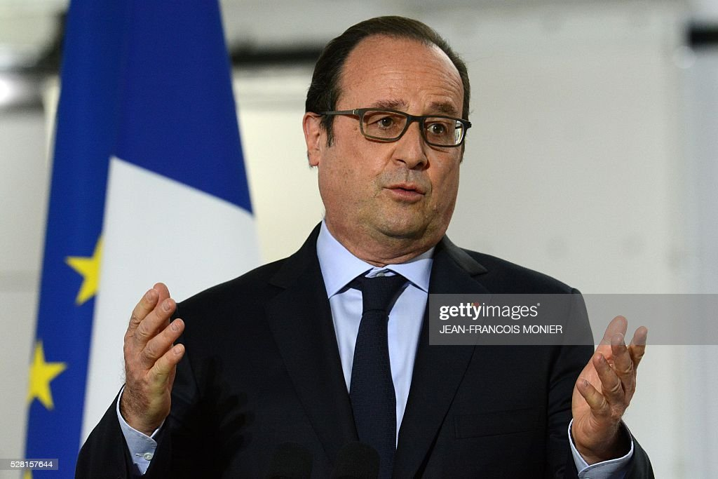 French President Francois Hollande gestures as he delivers a speech during a visit at the MK Automotive Mecachrome plant on May 4, 2016 in Sable-sur-Sarthe, northwestern France. / AFP / JEAN