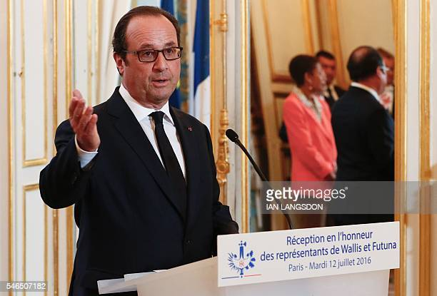French President Francois Hollande gestures as he delivers a speech during a reception held for representatives of Wallis and Futuna at the Elysee...