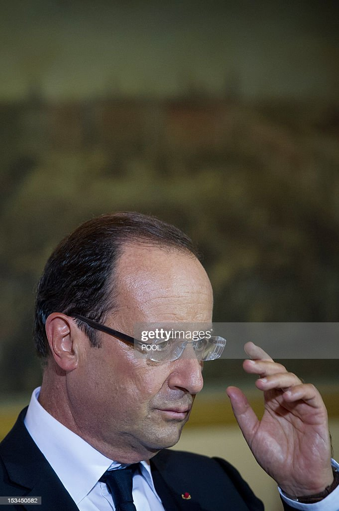 French President Francois Hollande gestures during a joint press conference with Malta's Prime Minister at the Verdala Palace in Valletta on October 5, 2012, during the 'Five-Plus-Five' summit. European and North African leaders held their first summit since the Arab Spring revolts today in Malta, where France, Italy, Portugal and Spain will also hold talks on the euro debt crisis.