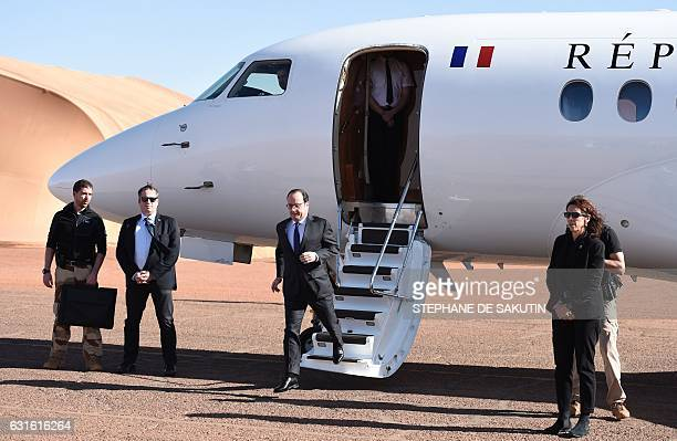 French President Francois Hollande gets out a plane prior to visit the troops of France's Barkhane counterterrorism operation in Africa's Sahel...