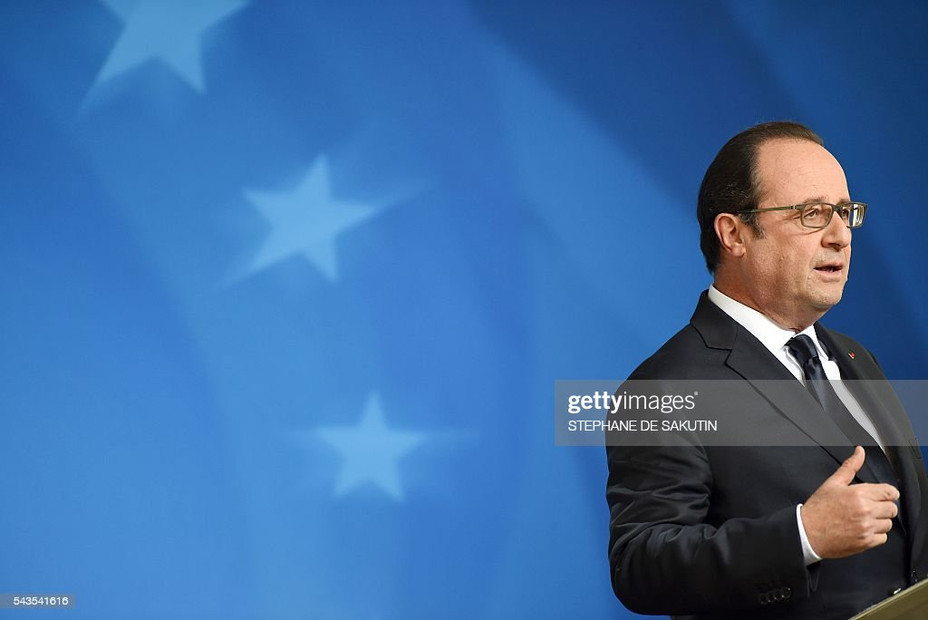 French President Francois Hollande gives a press conference during an European Union summit on June 29, 2016 at the European Union headquarters in Brussels. EU leaders agreed on June 29, 2016 that Britain cannot have access to the single market after leaving the union without accepting the bloc's rules on free movement, president Donald Tusk said. The summit will come just days after Britain's ruling Conservative party is due to choose a successor to Cameron, who resigned after his country voted in a referendum to leave the EU by 52 percent to 48. / AFP / STEPHANE