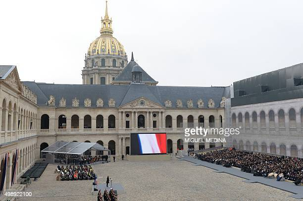 French President Francois Hollande gives a speech during the 'national and republican' tribute a solemn ceremony in honour of the 130 people killed...