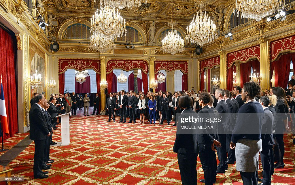 French President Francois Hollande (3dL) gives a speech to French medalists at the 2012 London olympics games, before he awards them with the French Legion d'Honneur during a ceremony on March 1, 2013 at the Elysee palace in Paris.
