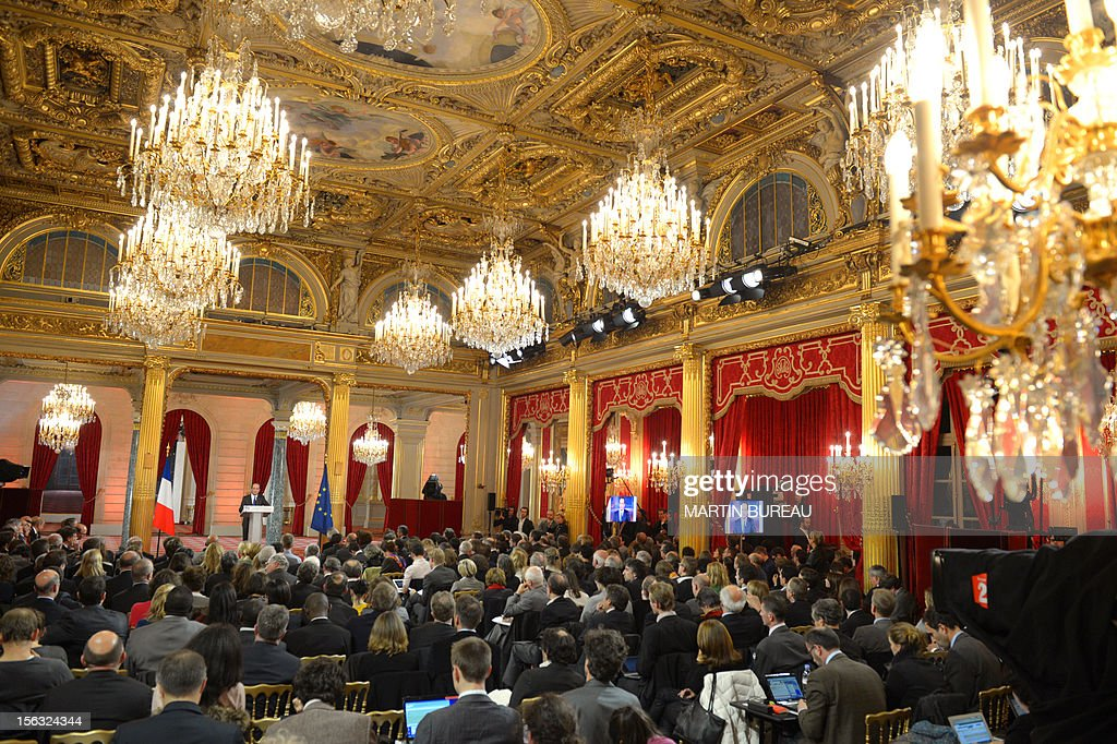 French President Francois Hollande (back) gives his first major press conference at the Elysee Place in Paris on November 13, 2012. Hollande holds his first major press conference amid rising discontent over the flagging economy and a slump in his personal poll ratings.