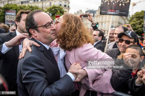 French President Francois Hollande greets a French Armenian during a ceremony marking the 102nd anniversary of the Armenian genocide in Paris on...