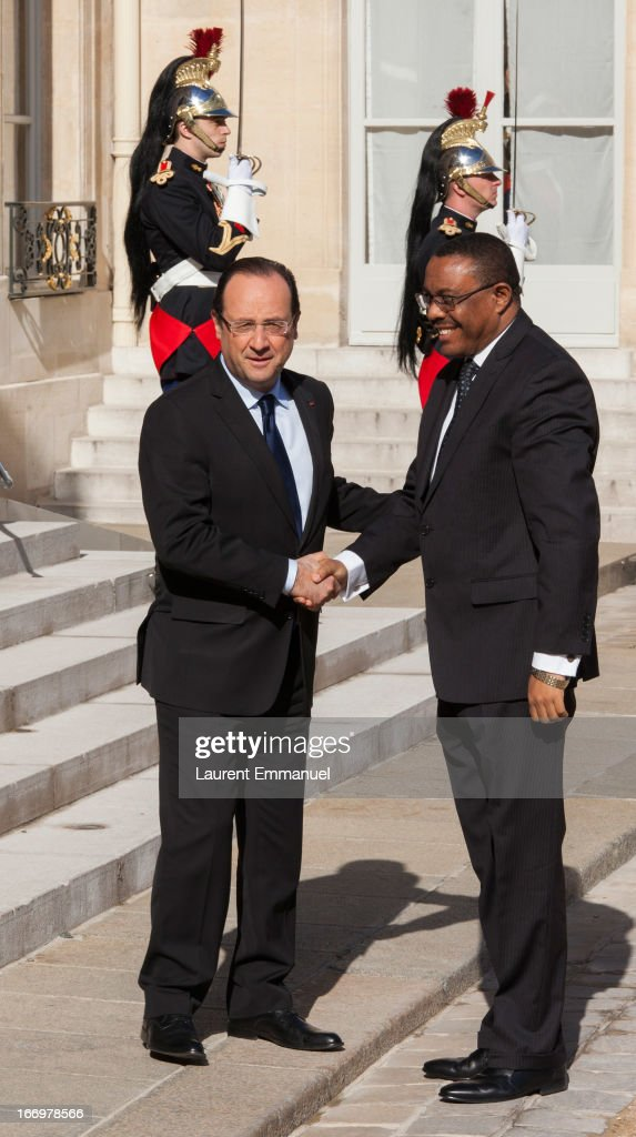 French President Francois Hollande (L) greets Ethiopian Prime Minister <a gi-track='captionPersonalityLinkClicked' href=/galleries/search?phrase=Hailemariam+Desalegn&family=editorial&specificpeople=7752700 ng-click='$event.stopPropagation()'>Hailemariam Desalegn</a> upon his arrival at Elysee Palace on April 19, 2013 in Paris, France. Prime Minister Hailemariam Dessalegn is on his first official visit to Europe after becoming the new Prime Minister of Ethiopia, and aims to improve relationships between Ethiopia and the EU during his visit.