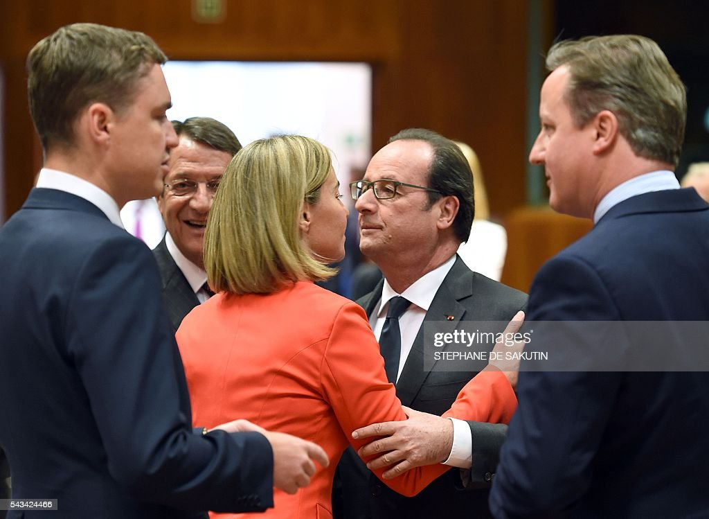French President Francois Hollande (C-R) greets European Union High representative for Foreign Affairs and Security Policy Federica Mogherini (C-L), as Estonian Prime Minister Taavi Roivas (L) and Britain Prime Minister David Cameron (R) talk, during an EU summit meeting on June 28, 2016 at the European Union headquarters in Brussels. Britain's exit from the European Union may erode the bloc's leadership role in fighting climate change and stymie crucial efforts to set more ambitious targets for cutting greenhouse gases, officials and experts said on June 28. European leaders meeting in Brussels pressured British Prime Minister David Cameron Tuesday to launch the two-year withdrawal process 'as soon as possible', but the embattled premier has vowed he will leave that task to a successor to be named on September 9. / AFP / STEPHANE