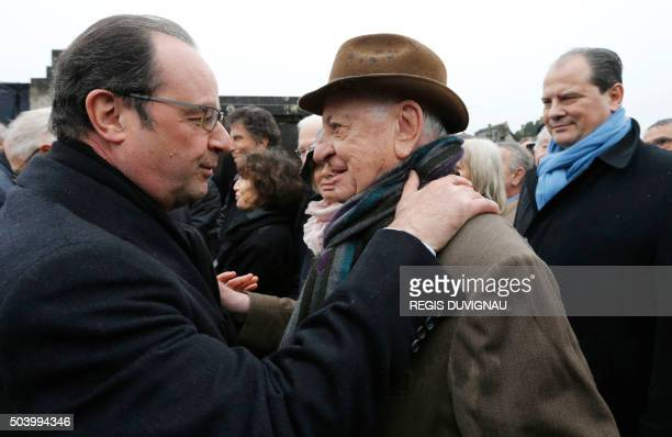 French President Francois Hollande greets French businessman Pierre Berge as French Socialist Party First Secretary JeanChristophe Cambadelis looks...