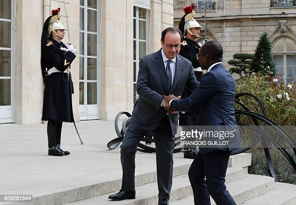 French President Francois Hollande greets his Benin counterpart Patrice Talon on December 12 2016 upon his arrival for their meeting at the Elysee...