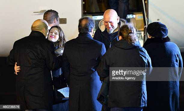 French President Francois Hollande greets Serge Lazarevic France's last remaining hostage as French Defence Minister JeanYves Le Drian greets...