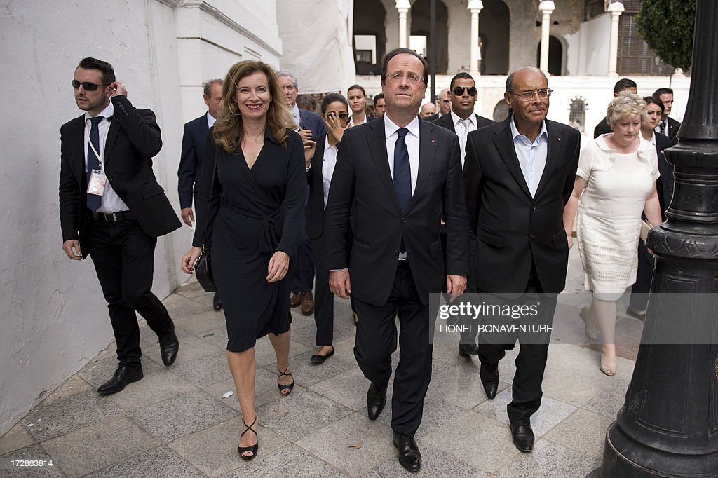 French President Francois Hollande, his companion Valerie Trierweiler and Tunisian presidential couple Moncef and Beatrix Marzouki are seen on July 5, 2013 after a lunch, in a Tunis restaurant. Hollande, whose two-day trip to Tunisia is the first by a French president since the January 2011 revolution that ousted veteran strongman and former French ally Zine El Abidine Ben Ali, expressed words of encouragement for Islamist-ruled country.