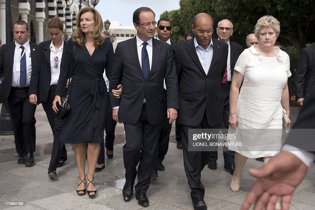 French President Francois Hollande, his companion Valerie Trierweiler and Tunisian presidential couple Moncef and Beatrix Marzouki are pictured on July 5, 2013 after a lunch, in a Tunis restaurant. Hollande, whose two-day trip to Tunisia is the first by a French president since the January 2011 revolution that ousted veteran strongman and former French ally Zine El Abidine Ben Ali, expressed words of encouragement for Islamist-ruled country.