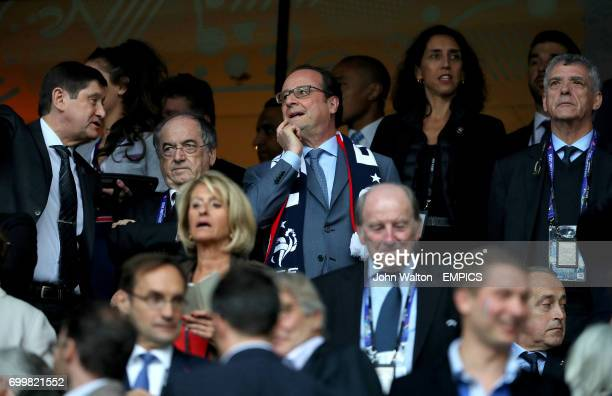 French President Francois Hollande in the stands before the game with French Football Federation President Noel Le Graet and Royal Spanish Football...