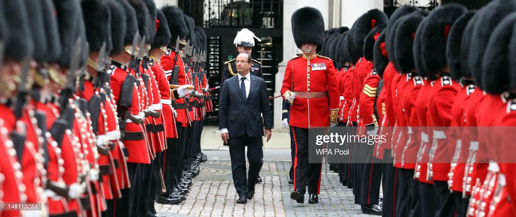 French President Francois Hollande inspects the guard of honour by the Coldstream Guards at the Foreign and Commonwealth Office on July 10, 2012 in London, England. This is the French President's first official visit to the United Kingdom since taking office, during which he will attend meetings with British Prime Minister David Cameron and Queen Elizabeth II.