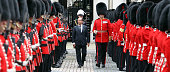 French President Francois Hollande inspects the guard of honour by the Coldstream Guards at the Foreign and Commonwealth Office on July 10 2012 in...