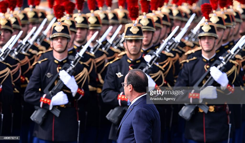 French President Francois Hollande inspects the Republican guards during annual Bastille Day military parade in the Republic Day on the Champs...