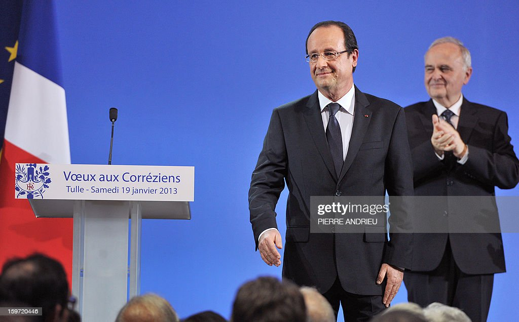 French President Francois Hollande (L) is applauded at the end of the New Year wishes ceremony for inhabitants of the Correze region, central France, on January 19, 2013 in Tulle.