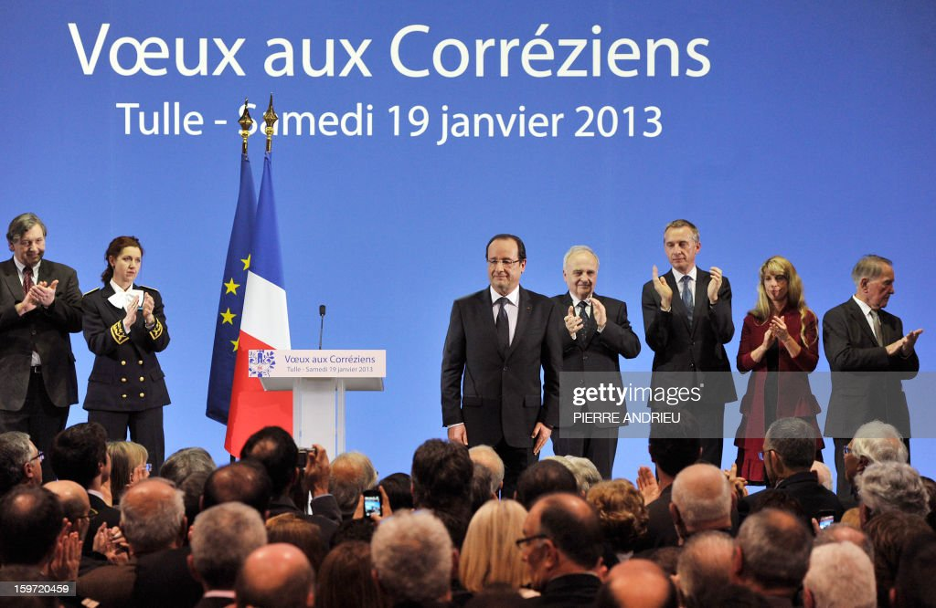 French President Francois Hollande (5thR) is applauded at the end of the New Year wishes ceremony for inhabitants of the Correze region, central France, on January 19, 2013 in Tulle.