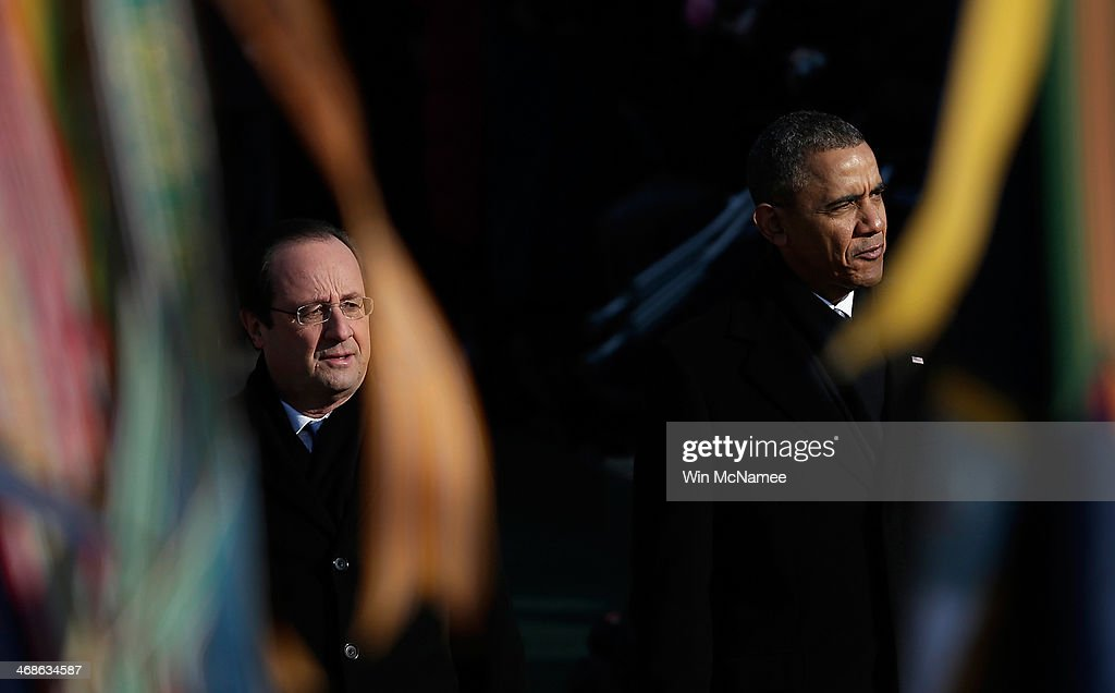 French President Francois Hollande (L) is escorted by U.S. President <a gi-track='captionPersonalityLinkClicked' href=/galleries/search?phrase=Barack+Obama&family=editorial&specificpeople=203260 ng-click='$event.stopPropagation()'>Barack Obama</a> (R) during a review of military troops at a welcoming ceremony on the South Lawn at the White House on February 11, 2014 in Washington, DC. Hollande who arrived yesterday for a three day state visit, visited Thomas Jefferson's Monticello estate and will be the guest of honor for a state dinner tonight.