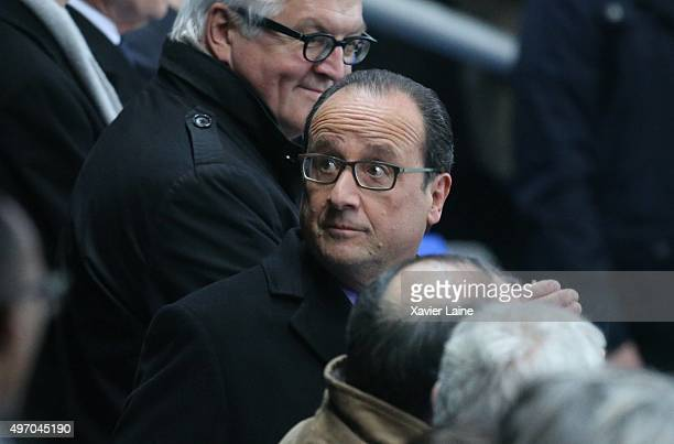 French President Francois Hollande is escorted out of the Stade de France by his security team before the end of the France v Germany International...