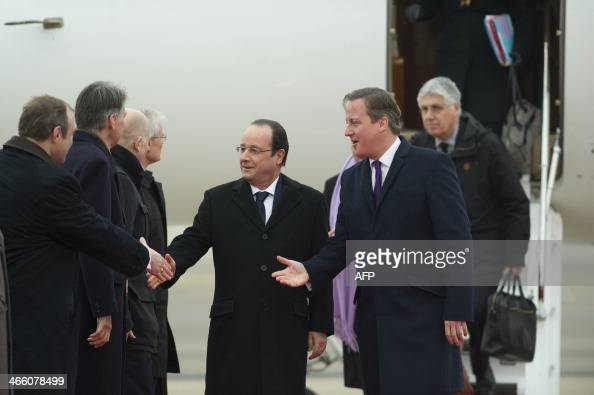 French president Francois Hollande is introduced to delegates by British Prime Minister David Cameron as they arrive for a meeting during a one day...