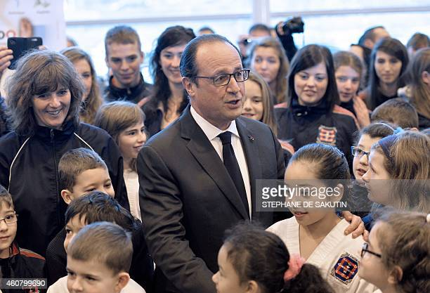 French President Francois Hollande is welcomed by children as he arrives at SaintPierre airport in the French northern Atlantic island of...
