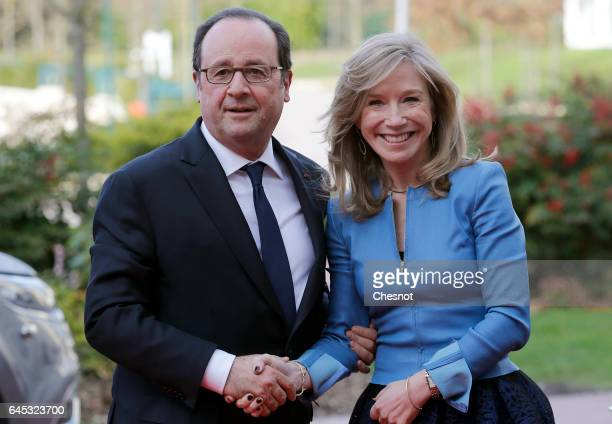 French President Francois Hollande is welcomed by Disneyland Paris President Catherine Powell as he arrives for a ceremony marking the 25th...