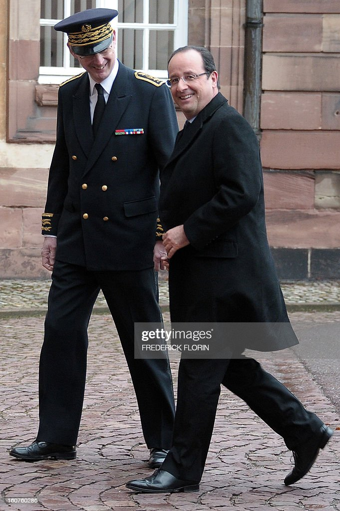 French President Francois Hollande (R) is welcomed by the prefect of Alsace region Stephane Bouillon upon his arrival at Strasbourg's prefecture, eastern France, on February 5, 2013, after his visit at the European Parliament.