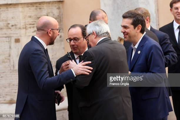 French President Francois Hollande jokes with EU Commission President Jean Claude Juncker and Greece's Prime Minister Alexis Tsipras as they arrive...