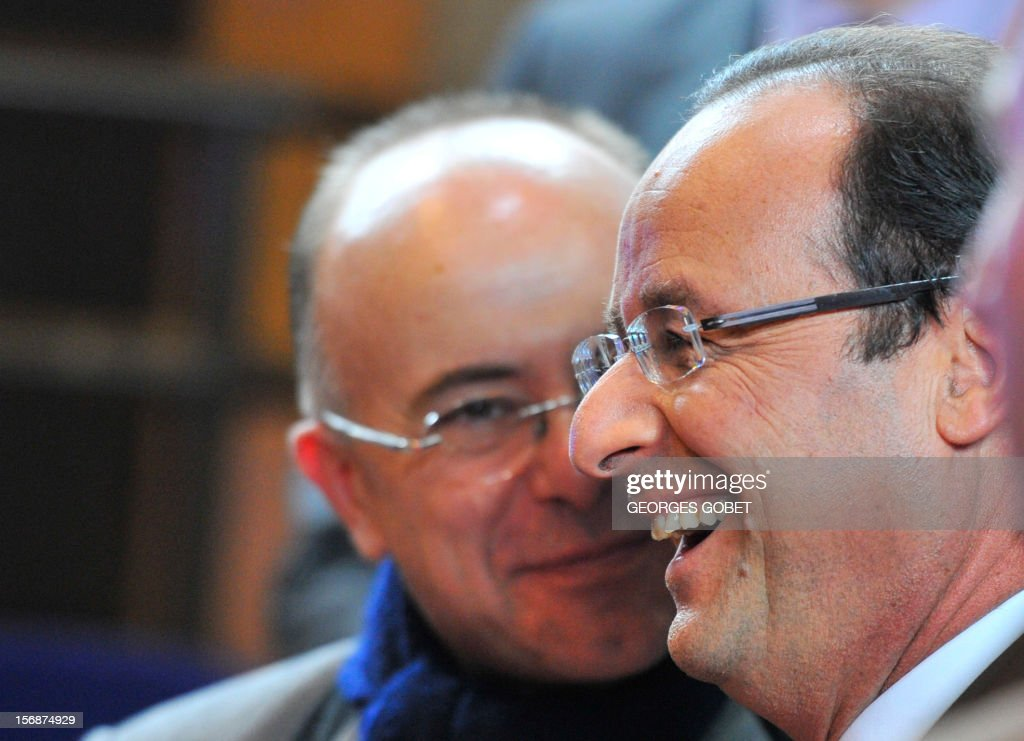 French President Francois Hollande (R) laughs with French European Affairs minister Bernard Cazeneuve as they leave the EU Headquarters, on November 23, 2012 in Brussels, after a two-day European Union leaders summit called to agree a hotly-contested trillion-euro budget through 2020. EU Council President Herman Van Rompuy said today that an EU budget deal was within reach early next year, after a two-day summit collapsed without agreement.