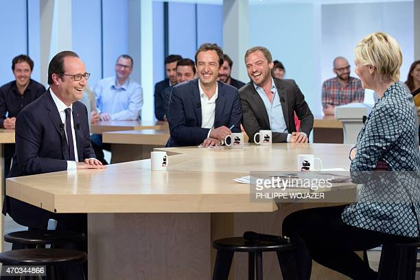 French President Francois Hollande laughs with TV show host Maitena Biraben and commentators Jerome Bermyn and Cyrille Eldin as he appears as a guest...