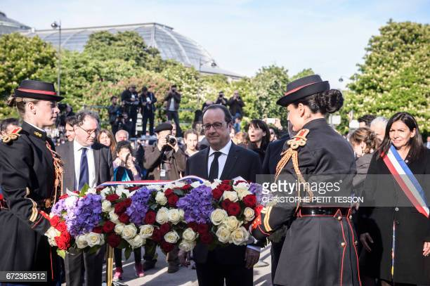 French President Francois Hollande lays a wreath during a ceremony marking the 102nd anniversary of the Armenian genocide in Paris on April 24 2017...