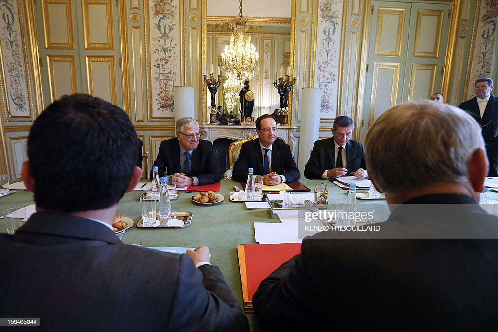 French President Francois Hollande (C) leads a meeting focused on the Malian situation next to his military chief of staff Benoit Pugat (2ndR) and General Secretary of the Elysee presidential palace, Pierre-Rene Lemas (2ndL) and with French Defence minister, French Foreign minister, French Prime Minister and French Interior minister, on January 14, 2013 at the Elysee Presidential palace in Paris. More than 60 Islamists were killed in their bases near the northern Malian city of Gao under intense bombardment by French air power, a security source and residents said today. 'France has attacked Islam. We will strike at the heart of France,' said Abou Dardar, a leader of Movement for Oneness and Jihad in West Africa, an offshoot of Al Qaeda in the Islamic Maghreb (AQIM), speaking to AFP by telephone.