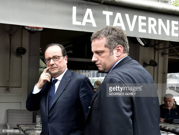 French President Francois Hollande leaves a restaurant in Tulle on May 7 after voting during the second round of the French presidential election /...
