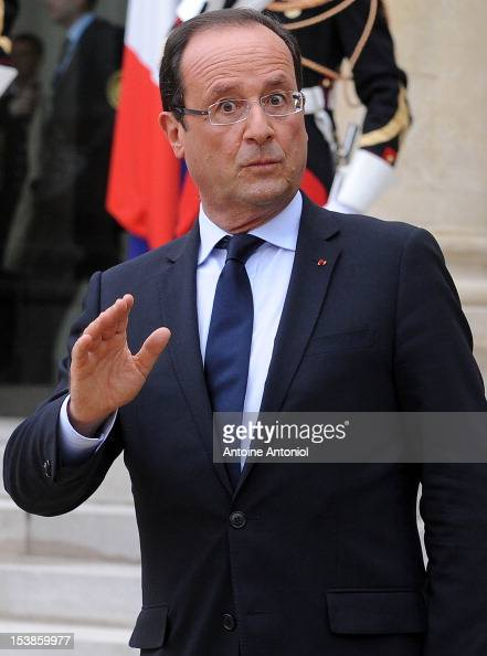 French President Francois Hollande leaves after a news confrence at the Elysee Palace on October 10 2012 in Paris France The bilateral meeting is due...