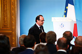 French President Francois Hollande leaves after delivering a speech during a ceremony marking the first anniversary of the energy transition law at...